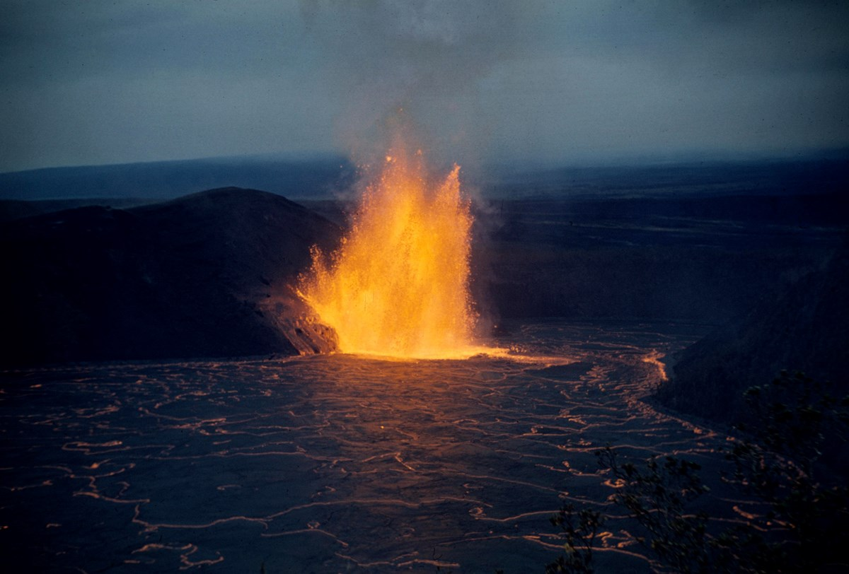 Lava fountain shimmers across lava lake in Kilauea Iki Crater