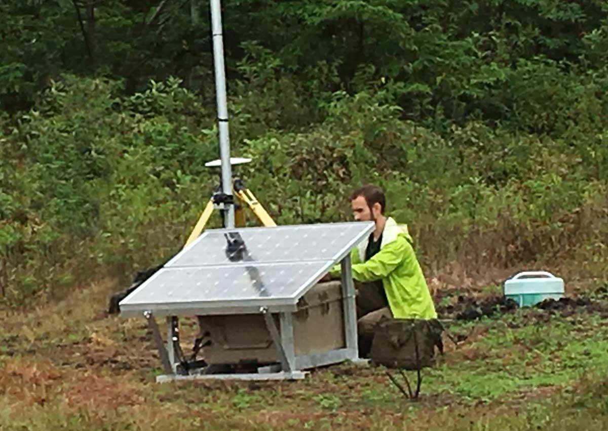 Seismologist checks seismic station