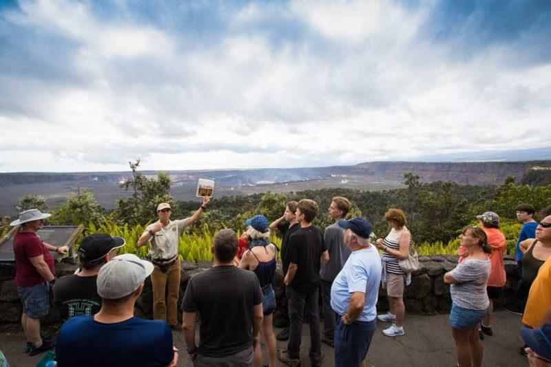 Volunteer giving group program in front of Kilauea Caldera